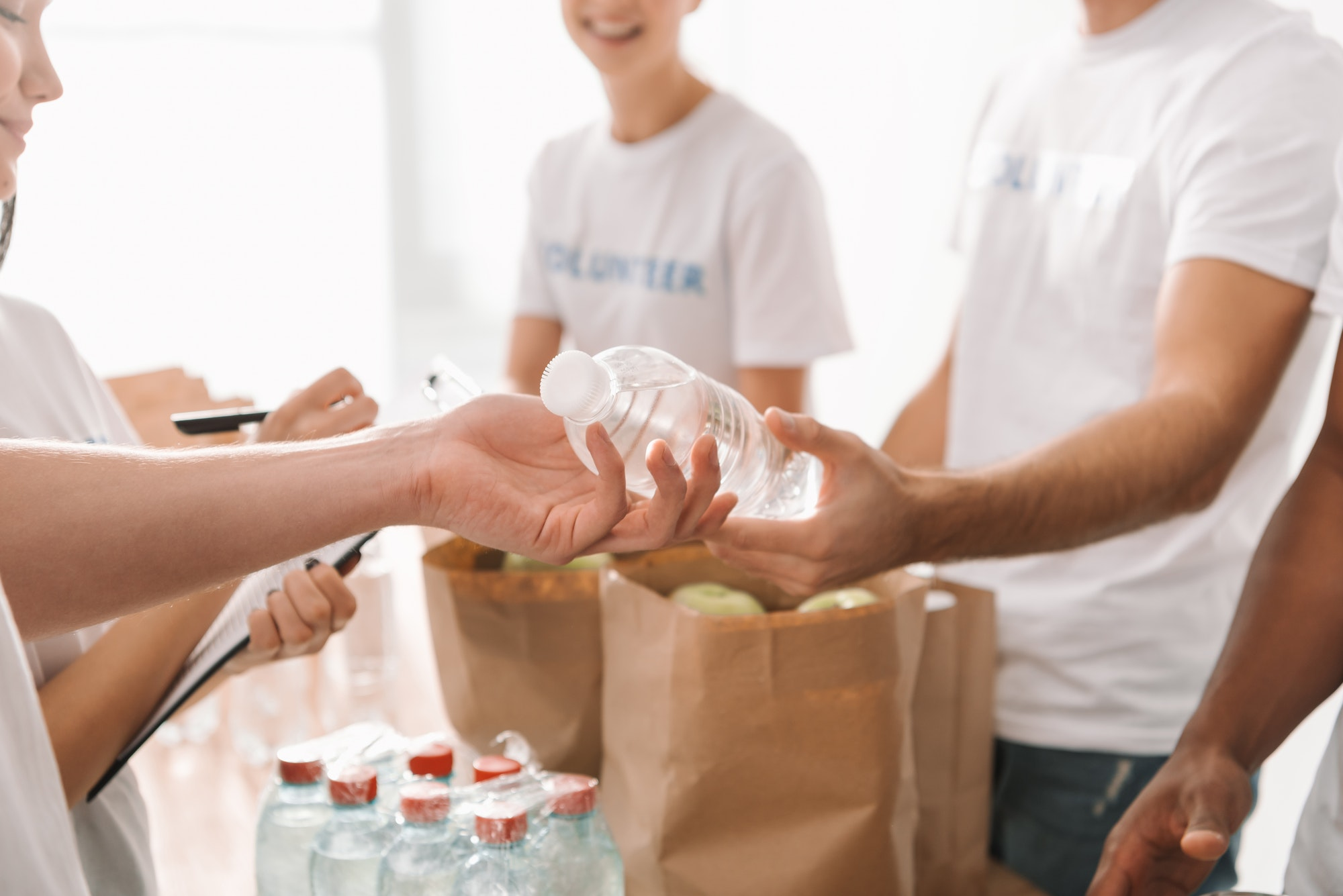 cropped-shot-of-volunteers-with-food-and-drinks-for-charity.jpg