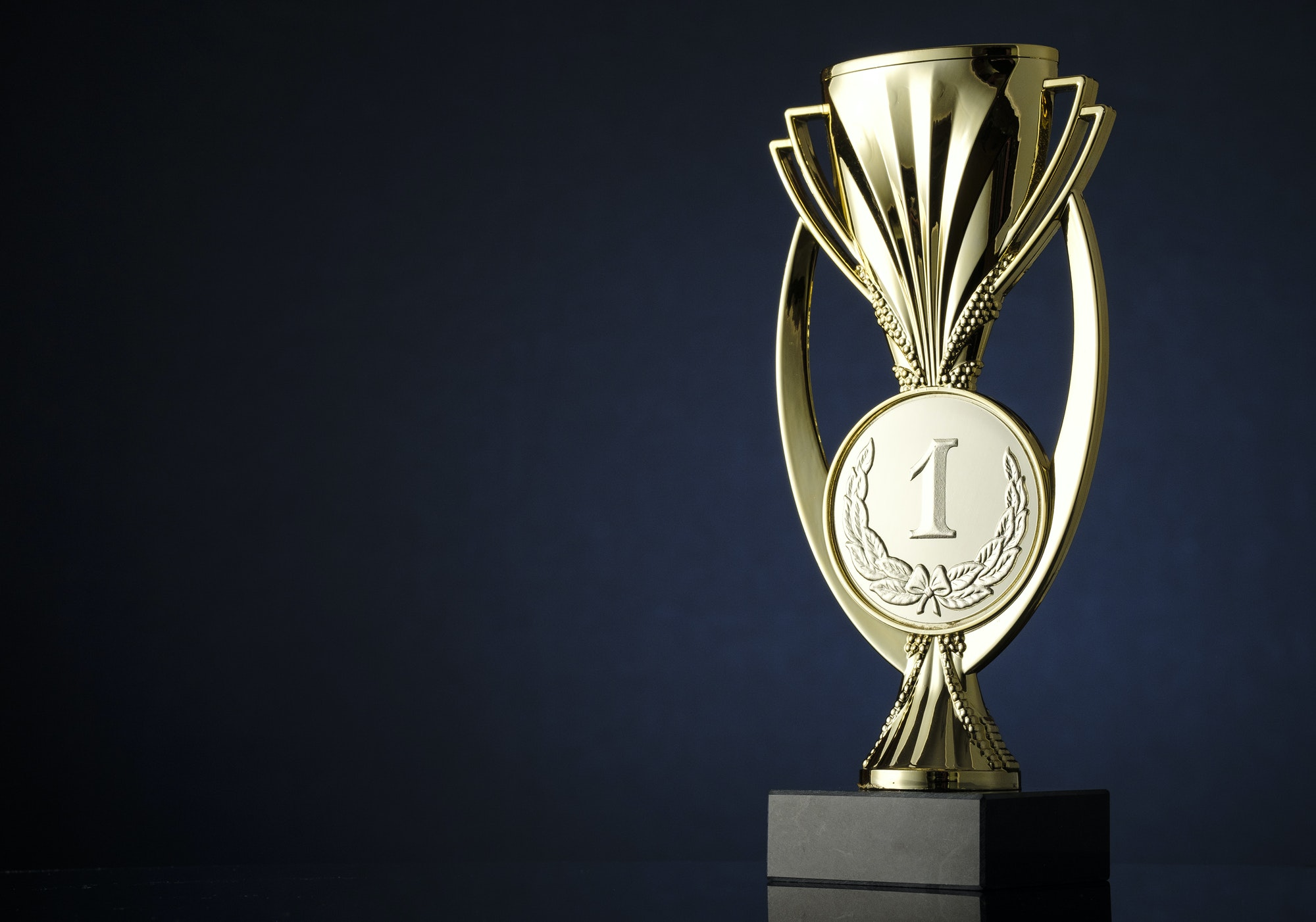 Gold cup or trophy with medallion for the winner