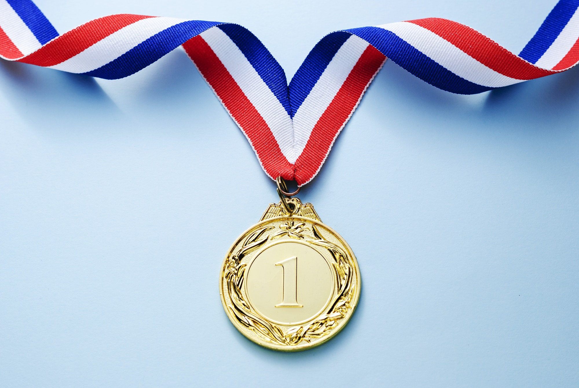 Gold medal 1 place with a ribbon